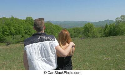 Teenage couple enjoying nature