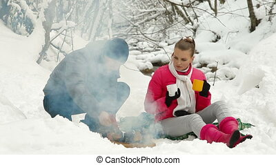 Winter Holidays by Bonfire in Snow