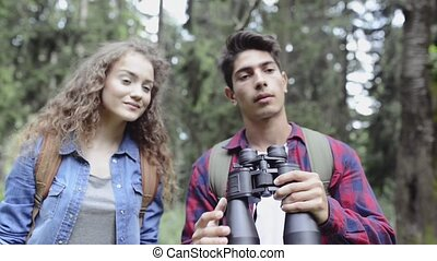 Teenage couple hiking in forest. Summer vacation. - Teenage...
