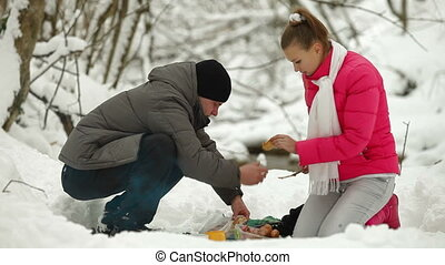 Teenage Couple in Winter Forest