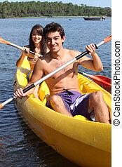 Teenage couple kayaking