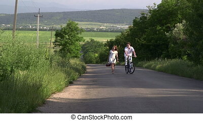 Teenage couple on a country road