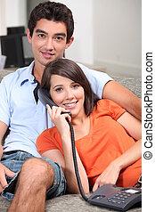 Teenage couple on the phone