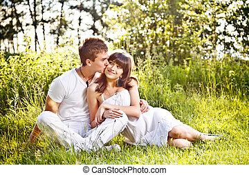Teenage couple sitting in park