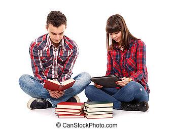 Teenage couple studying together