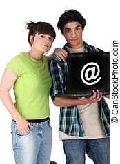 Teenage couple with a laptop