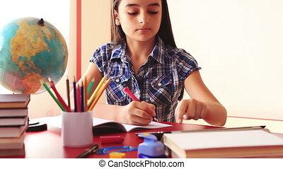 Teenage doing homework on tablet pc
