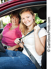 Teenage Driver Fastens Seatbelt