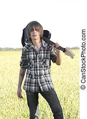 Teenage emo guitarist - Young rocker posing with musical ...