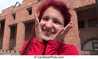 Teenage Female Redhead Making Funny Faces And Acting Goofy