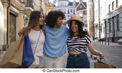 Teenage friends shopping during sale season
