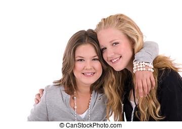 Teenage friendship - Two cute teenagers hugging each other