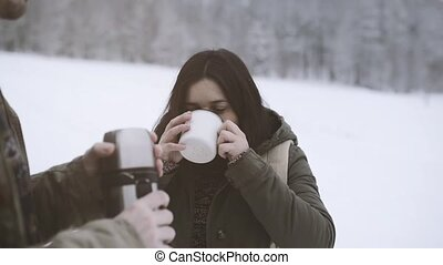 Teenage girl and boy in winter nature. - Teenage girl and...