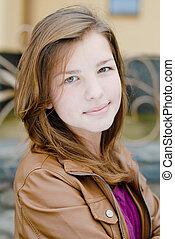 Teenage girl autumn day portrait