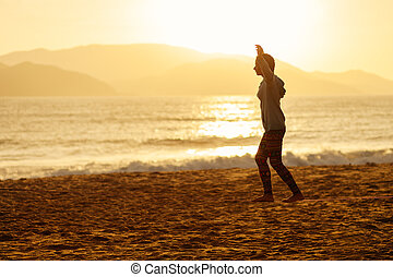 teenage girl  balance slackline silhouette on the beach