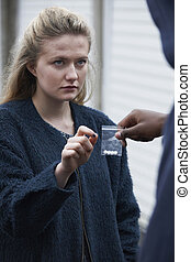 Teenage Girl Buying Drugs On The Street