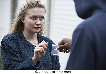 Teenage Girl Buying Drugs On The Street