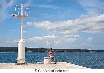 Teenage girl by the sea