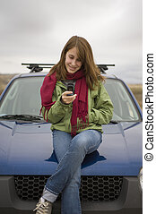 Teenage girl calling on her cell phone