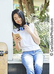 Teenage girl checking smartphone