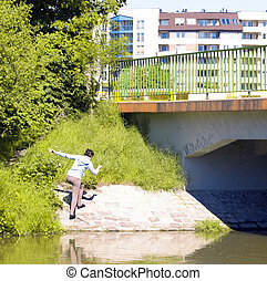 Teenage girl going under the bridge in Wroclaw, Poland