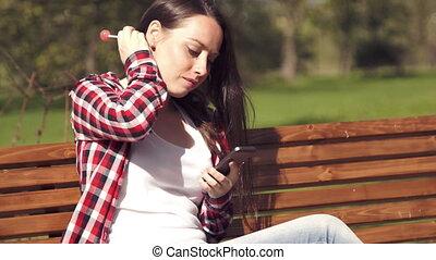 Teenage girl having fun chatting with boyfriend