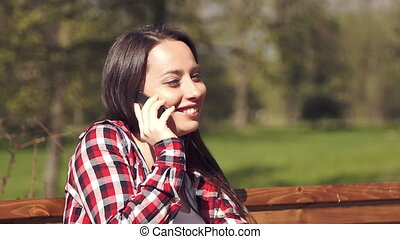 Teenage girl having fun talking on the phone
