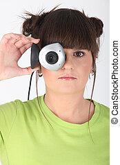 Teenage girl holding a webcam