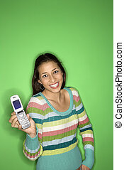 Teenage girl holding cellphone.