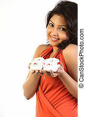 Teenage girl holding small shoes