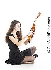 teenage girl holds violin in studio