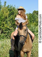 teenage girl horseback riding