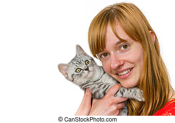 Teenage girl hugging young tabby cat