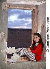 Teenage girl in abandoned building - A teenage girl model...