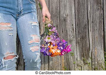 teenage girl in distressed denim jeans
