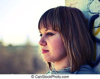 Teenage girl in front of school