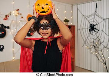 Teenage girl in Halloween costume
