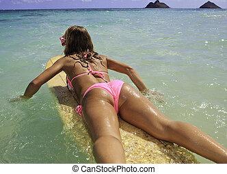 girl in pink bikini at the beach in hawaii