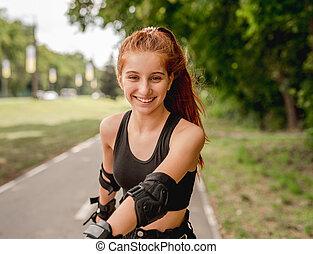 Teenage girl in sportswear roller skating