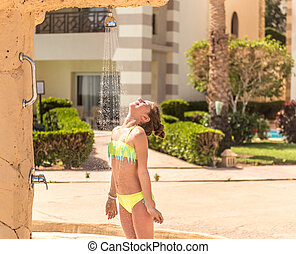 Teenage girl in the shower outside of hotel