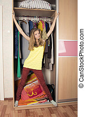teenage girl in wardrobe at home