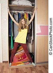 teenage girl in wardrobe at home