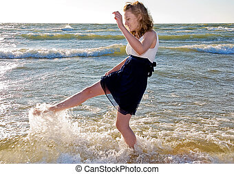 Teenage girl in water