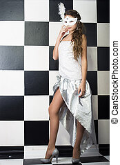 girl in white mask at checkerboard background