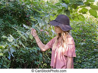 teenage girl in woods