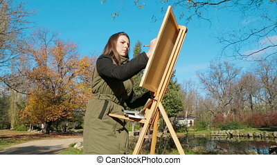 Teenage Girl Is Drawing a Picture In Park