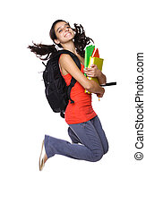 teenage girl jumping with books in