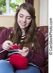 Teenage Girl Knitting At Home