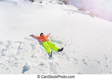 Teenage girl lay in star shape wear ski outfit
