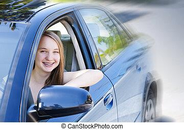 Teenage girl learning to drive - Teenage female driving...